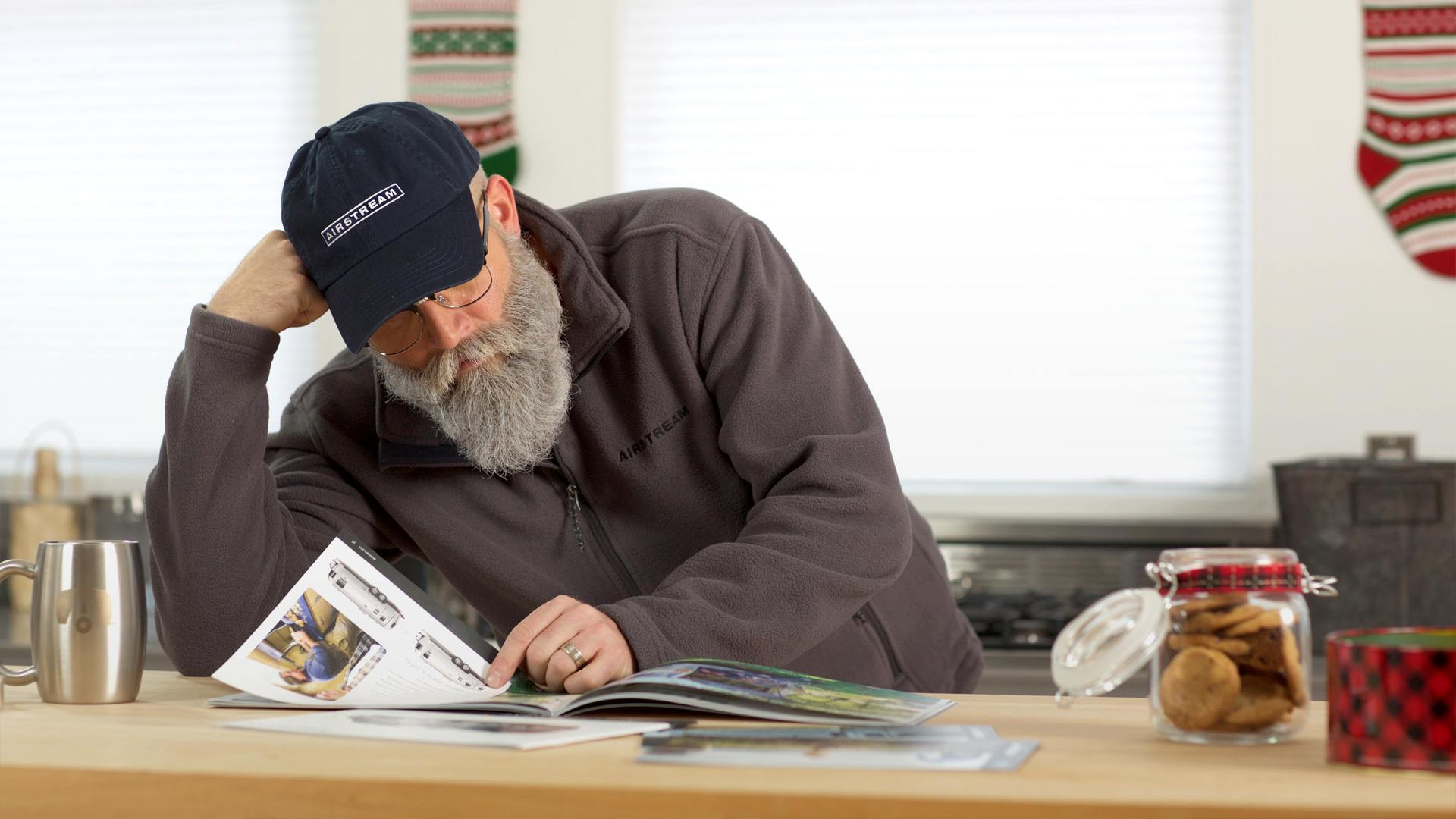 Santa Looking at an Airstream Brochure