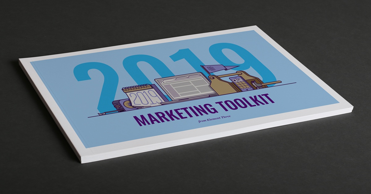 blue marketing toolkit laying on black table