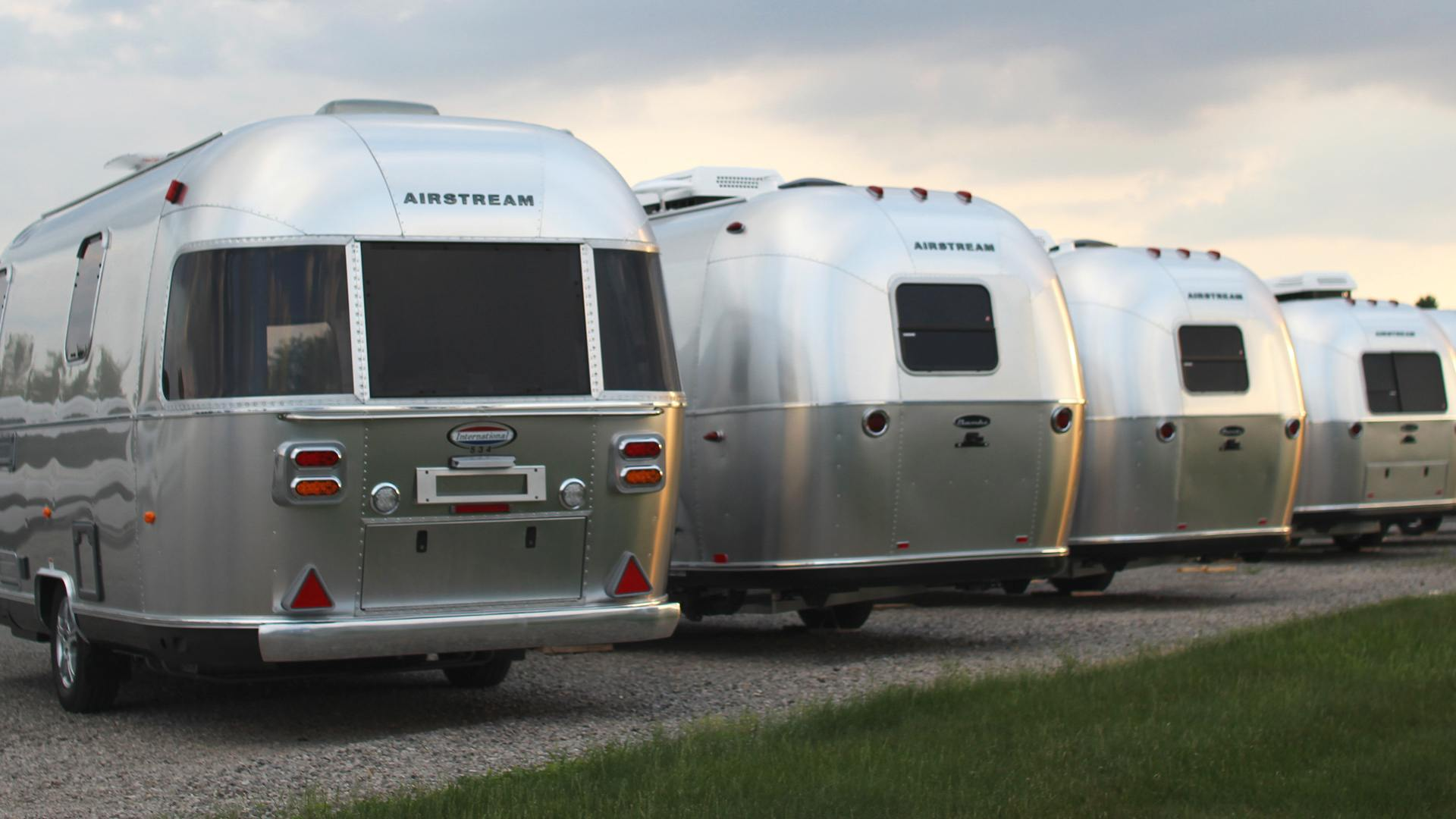 row of airstream trailers parked