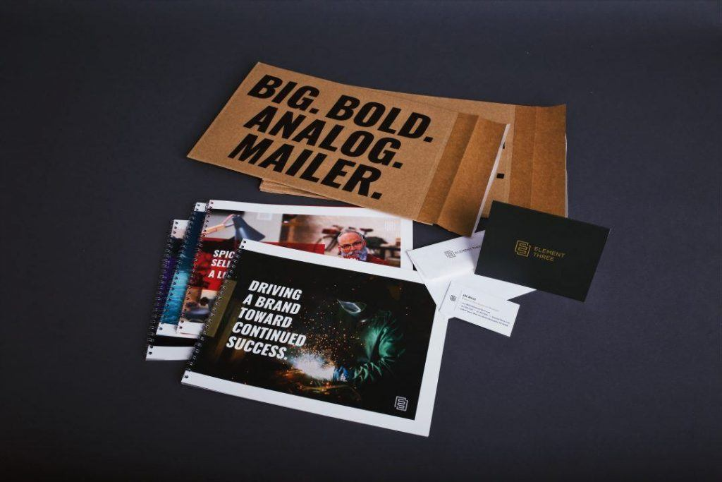 E3 Direct Mail Campaign Showcasing Case Studies and Branded Envelopes