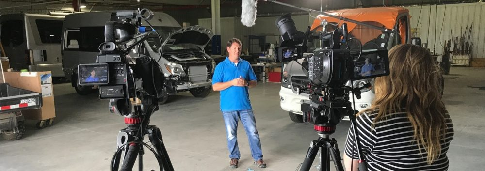 video crew filming in an RV workshop